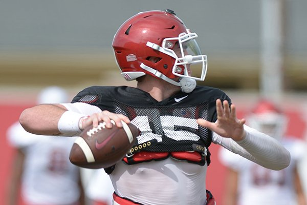 Arkansas quarterback Cole Kelley passes Tuesday, Aug. 7, 2018, during practice at the university practice fields in Fayetteville.