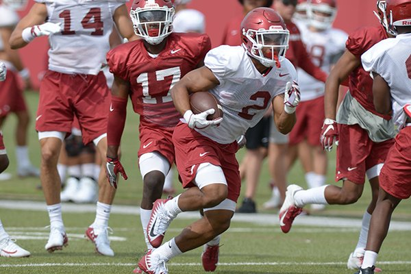 Arkansas running back Chase Hayden (2) carries the ball Tuesday, Aug. 7, 2018, during practice at the university practice fields in Fayetteville.