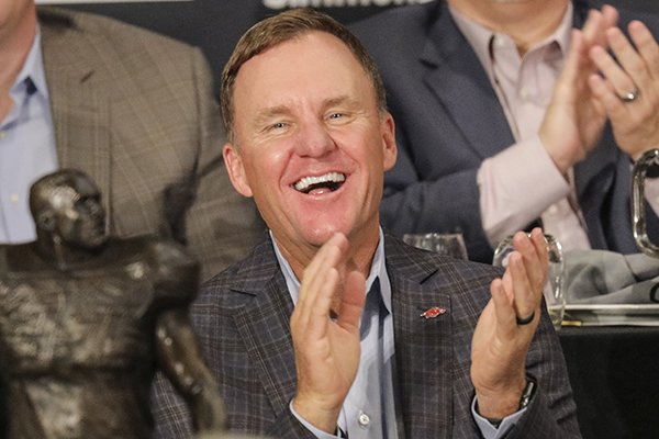 Arkansas coach Chad Morris laughs as he is introduced before speaking to the Little Rock Touchdown Club on Monday, Aug. 20, 2018, at Embassy Suites Hotel in Little Rock.