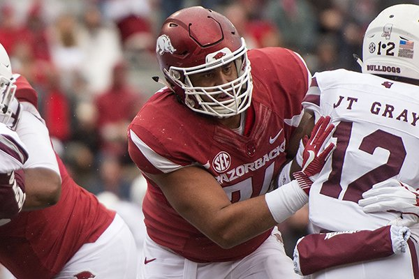 Arkansas offensive lineman Colton Jackson blocks Mississippi State J.T. Gray during a game Saturday, Nov. 18, 2017, in Fayetteville.