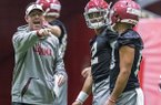Alabama quarterbacks coach Dan Enos directs passing drills as quarterbacks Jalen Hurts (2) and Tua Tagovailoa (13) listen during the NCAA college football team's spring practice Tuesday, March 20, 2018, in Tuscaloosa, Ala. (Vasha Hunt/AL.com via AP)