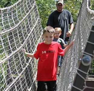 NEW HEIGHTS: Jackson Boston and Koehn Cartright play on the Bob Wheeler Science Skywalk at Mid-America Science Museum during the Summer Science Smash on Aug. 25. Voters on Sept. 11 approved a $2 million bond issue to add a new exhibition hall.