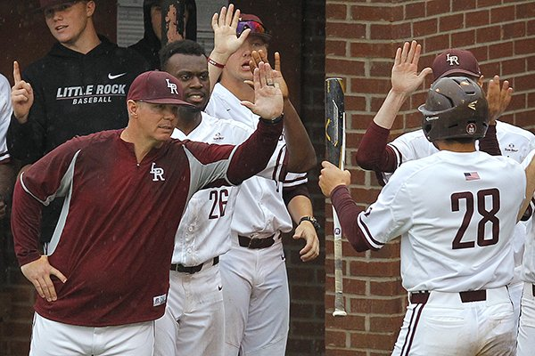 UALR head coach Chris Curry (left) congratulates Nick Perez after he scored in the bottom of the third inning during the Trojans' game against South Alabama on Friday, May 4, 2018, at Gary Hogan Field in Little Rock.