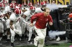 In this Jan. 8, 2018, file photo, Alabama head coach Nick Saban leads his team on the field before the NCAA college football playoff championship game against Georgia, in Atlanta. (AP Photo/David Goldman,)
