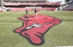 The Arkansas Razorbacks logo is shown at midfield of Donald W. Reynolds Razorback Stadium on Monday, Aug. 27, 2018, in Fayetteville.
