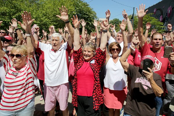 NWA Democrat-Gazette/DAVID GOTTSCHALK University of Arkansas Razorback fans participate in the Hog Call Friday during the ONE Hog Call event at the Town Center in downtown Fayetteville. The ONE Hog Call took place at 1:00 p.m. central standard time and asked fans in specific and spontaneous locations to participate in the cheer in an effort to unite Razorback fans across the globe. For more photographs and to hear the ONE Hog Call go to NWADG.com/photo and NWADG.com/video.