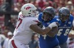 Arkansas defensive lineman Briston Guidry (7) is blocked by Eastern Illinois offensive lineman Johari Branch (64) during a game Saturday, Sept. 1, 2018, in Fayetteville.