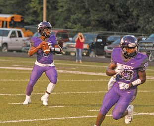 Terrance Armstard/News-Times El Dorado quarterback Alex Hicks drops back to pass in action Friday night against Camden Fairview. Hicks has accounted for eight touchdowns in the Wildcats' first two games this season.