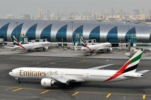 FILE - In this March 22, 2017, file photo, an Emirates plane taxis to a gate at Dubai International Airport in Dubai, United Arab Emirates. A false claim by Yemen's Houthi rebels of an attack on Dubai International Airport, the world's busiest airport for international travel, this week may have been quickly disproven by authorities in Dubai, but it shows the looming threats in the region. (AP Photo/Adam Schreck, File)