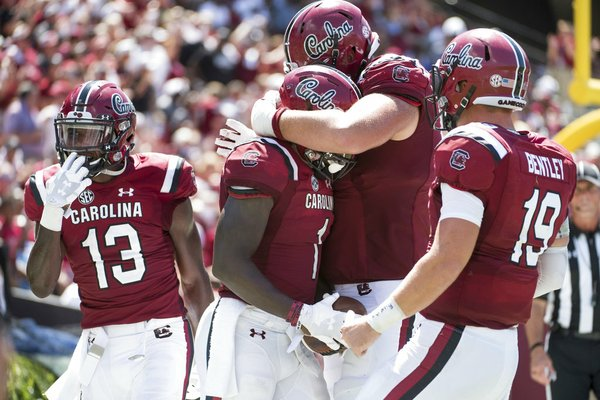 South Carolina wide receiver Deebo Samuel (1) celebrates his touchdown reception with Blake Camper, right, Jake Bentley (19), and Shi Smith (13) during the second half against Coastal Carolina on Saturday, Sept. 1, 2018, in Columbia, S.C.