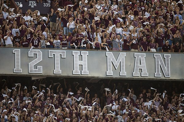Texas A&M fans wave towels and cheer during the first half of an NCAA college football game against Northwestern State Thursday, Aug. 30, 2018, in College Station, Texas. (AP Photo/Sam Craft)