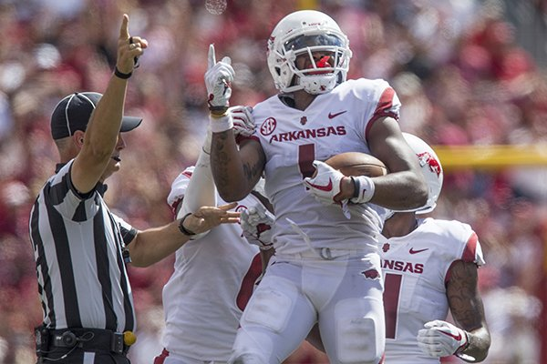 Chevin Calloway, Arkansas cornerback, celebrates after recovering an Eastern Illinois fumble Saturday, Sept. 1, 2018, in the first quarter at Razorback Stadium in Fayetteville.