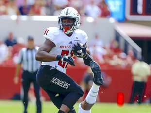 Arkansas State tight end Javonis Isaac (81) tries to break free from the tackle of Alabama defensive back Xavier McKinney (15) during the first half of an NCAA college football game, Saturday, Sept. 8, 2018, in Tuscaloosa, Ala. (AP Photo/Butch Dill)