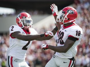 Georgia defensive back Deandre Baker (18) and Richard LeCounte (2) celebrate a defensive play against South Carolina during the first half of an NCAA college football game Saturday, Sept. 8, 2018, in Columbia, S.C. (AP Photo/Sean Rayford)