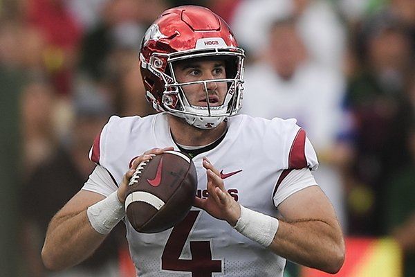 Arkansas Razorbacks quarterback Ty Storey (4) looks for a receiver during the second quarter of a football game, Saturday, September 8, 2018 at Colorado State University in Fort Collins, Colo.