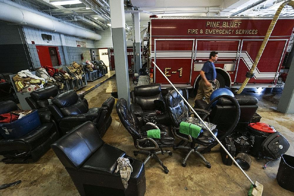 Chairs, equipment and gear dry out in Fire Station No. 1 in Pine Bluff on Sunday after overnight flooding caused damage at the Joe Thomas Public Safety Facility.