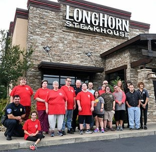 The Sentinel-Record/Grace Brown- Members of the Hot Springs Police Department, Abilities Unlimited Hot Springs, Civitan Services of Bryant, and LongHorn Streakhouse staff have their photo taken on Thursday, September 6, 2018, in front of the steakhouse to promote their Tip a Hero event held on Thursday, September 13, 2018.