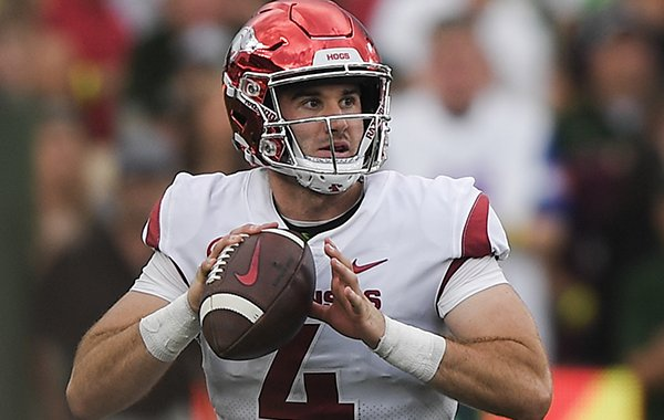 Arkansas quarterback Ty Storey looks to throw during a game against Colorado State on Saturday, Sept. 8, 2018, in Fort Collins, Colo.
