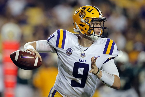 LSU quarterback Joe Burrow (9) scrambles as he looks for a receiver in the second half of an NCAA college football game against Southeastern Louisiana in Baton Rouge, La., Saturday, Sept. 8, 2018. LSU won 31-0. (AP Photo/Gerald Herbert)
