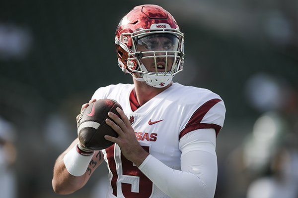 Arkansas Razorbacks quarterback Cole Kelley (15) practices his throw before a football game, Saturday, September 8, 2018 at Colorado State University in Fort Collins, Colo.