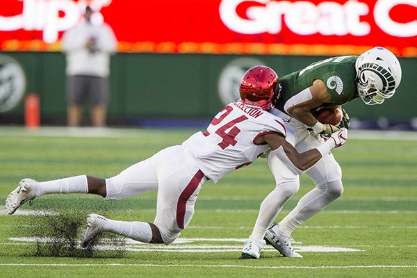 Jarques McClellion, Arkansas cornerback, tackles Olabisi Johnson, Colorado State wide receiver, in the 2nd quarter Saturday, Sept. 8, 2018, at Canvas Stadium in Fort Collins, Colo.