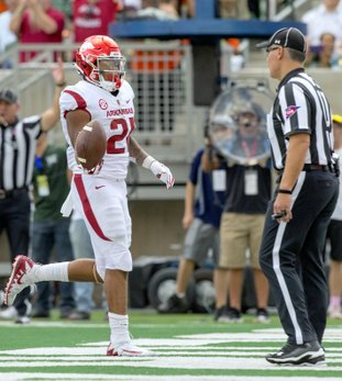 NWA Democrat-Gazette/Ben Goff RUNNING GAME: Arkansas running back Devwah Whaley scores a touchdown in the second quarter Saturday in Fort Collins, Colo., during the Razorbacks' 34-27 loss at Colorado State.