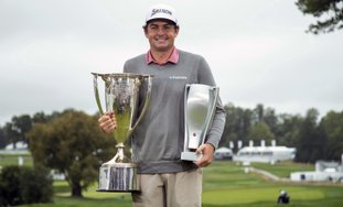The Associated Press DRIVING MACHINE: Keegan Bradley poses with the two trophies following his win on Monday at the BMW Championship golf tournament at the Aronimink Golf Club in Newtown Square, Pa.