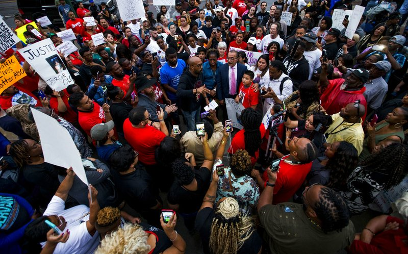 Protesters angered by fatal shooting of Harding grad bring