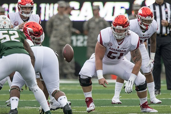 Arkansas center Hjalte Froholdt (51) snaps the ball during a game against Colorado State on Saturday, Sept. 8, 2018, in Fort Collins, Colo.