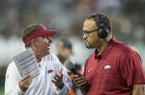 Arkansas coach Chad Morris (left) talks to Razorback Sports Network reporter Geno Bell during a game against Colorado State on Saturday, Sept. 8, 2018, in Fort Collins, Colo.