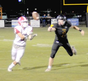 MARK HUMPHREY ENTERPRISE-LEADER Prairie Grove sophomore Cade Grant broke up this Dardanelle pass. The Tigers were beaten 35-17 by the Sandlizards Friday leaving Prairie Grove still searching for its first football win of the 2018 season.
