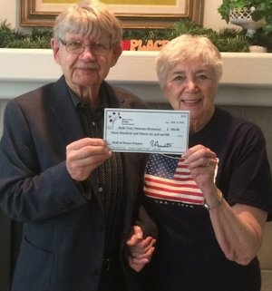 Photo submitted Robert Gromatka, tournament chairman, presents a check for $396 to Julie Storm, a member of Northwest Arkansas Veterans Council. The money was raised during the three-day Bella Vista NLM Bridge Tournament.