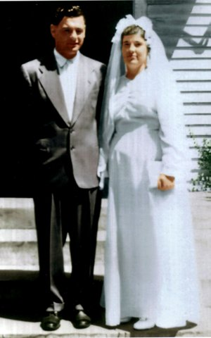 Submitted Photo Winfield and Laura Fern Poe pose on the steps of the chapel at the Church of God Holiness school at Mt. Zion, Mo., on their wedding day, Aug. 4, 1948. The chapel is on the campus where they first met when Winfield enrolled in Laura's class.
