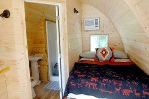 "Lynn Atkins/The Weekly Vista Finishing touches are still in the works for Bella Vista's first ""glamping pod"" at Blowing Springs Park. The pod sleeps two people and has its own bathroom, as well as a microwave and a small refrigerator."