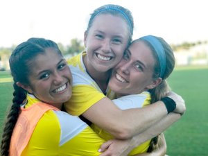 Photo submitted John Brown University women's soccer players Natalie Aycock, Sienna Nealon and Aspen Carpenter celebrate after Nealon scored the game winning penalty kick last Saturday against William Carey (Miss.) in Orange Beach, Ala.