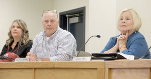 LYNN KUTTER ENTERPRISE-LEADER Farmington City Council members Sherry Mathews, left, Keith Lipford and Linda Bell listen as members of the public address them about a resolution to increase the mayor's salary to $72,000.