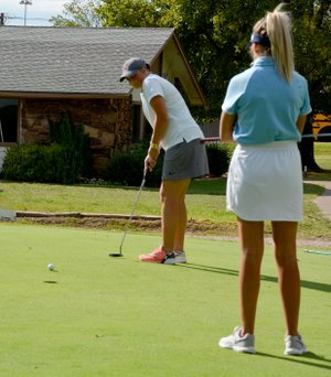 Graham Thomas/Herald-Leader Siloam Springs senior McKenzie Blanchard attempts a putt on hole No. 9 Monday in a nine-hole tri-match with Springdale Har-Ber and Van Buren at Siloam Springs Country Club.