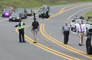 The Sentinel-Record/Richard Rasmussen CRIME SCENE: Hot Springs police detectives work the scene of a reported shooting early Tuesday on Carpenter Dam Road near Lake Park Drive in which a local woman, 37, was injured. Police said they are investigating the incident as a case of domestic violence and a local man, Nelson Green Johnson III, 37, was arrested for violation of a protection order.