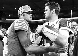 The Associated Press QB CONTRAST: Lions quarterback Matthew Stafford, left, meets with New York quarterback Sam Darnold Monday after the Jets' 48-17 win Monday in Detroit.