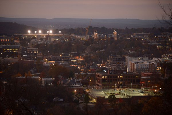The sun sets over downtown Fayetteville and the University of Arkansas on Nov. 16, 2017.