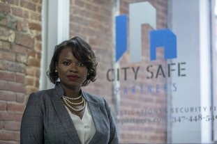 """In this Sept. 7 photo, Soyini Chan-Shue poses for a portrait at City Safe Partner's office in New York. Although Chan-Shue easily delegated work to police officers when she was a sergeant in the New York City Police Department, it was hard to relinquish tasks to employees of the security firm she now owns. """"It can be nerve-wracking to give my staffers the autonomy to make decisions I formerly made, but I realized that I can't effectively grow my business if I don't,"""" says Chan-Shue, CEO of City Safe Partners. (AP Photo/Mary Altaffer)"""