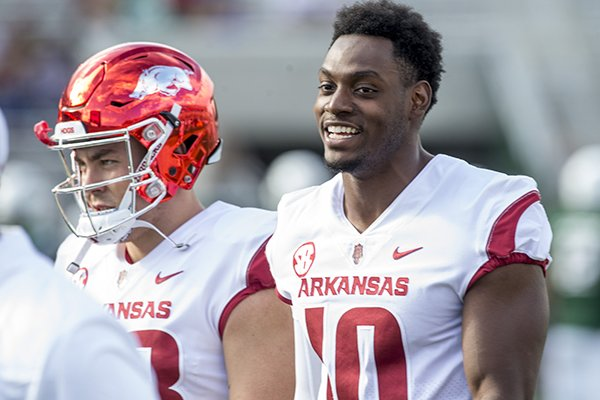 Arkansas defensive end Randy Ramsey (10) watches warmups prior to the Razorbacks' game against Colorado State on Saturday, Sept. 8, 2018, in Fort Collins, Colo.