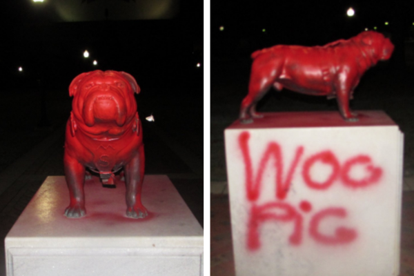 "Mississippi State University police say vandals spray painted the words ""Woo Pig"" on a statue of the school's bulldog mascot."