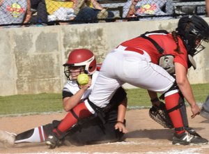 Rick Peck/Special to McDonald County Press McDonald County's Whitney Kinser scores a run on a squeeze bunt by Alexa Hopkins during the Lady Mustangs' 10-0 win over Aurora on Sept. 6 at MCHS.