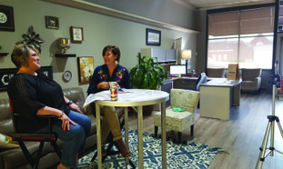 """Columbia County Fair and Livestock Show President Sonya Caldwell (left) talks with Magnolia-Columbia County Chamber of Commerce Director Ellie Baker Wednesday morning during """"Chamber Talk,"""" a weekly Facebook Live online community chat show. The County Fair begins Monday, Sept. 17 and lasts through Saturday, Sept. 22."""