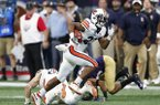 Auburn Tigers wide receiver Ryan Davis (23) runs against Washington in the first half of an NCAA college football game Saturday, Sept. 1, 2018, in Atlanta. (AP Photo/John Bazemore)