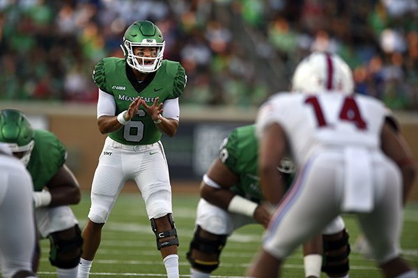 North Texas quarterback Mason Fine (6) prepares to begin a play during an NCAA college football game against SMU on Saturday, Sept. 1, 2018 at Apogee Stadium in Denton, Texas. (Jake King/The Denton Record-Chronicle via AP)