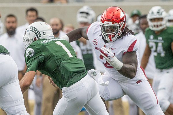 Arkansas defensive lineman McTelvin Agim chases down Colorado State quarterback K.J. Carta-Samuels during a game Saturday, Sept. 8, 2018, in Fort Collins, Colo.