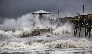 Waves slam the Oceana Pier & Pier House Restaurant in Atlantic Beach, N.C., Thursday, Sept. 13, 2018 as Hurricane Florence approaches the area. (Travis Long/The News & Observer via AP)