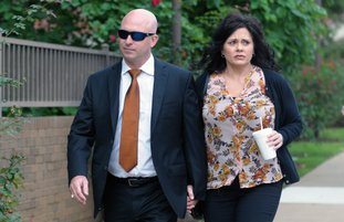 Former state representative Micah Neal (left) walks Thursday, September 13, 2018, with his wife Cindy to the John Paul Hammerschmidt Federal Building in Fayetteville. Neal was to be sentenced for conspiracy to commit fraud in kickback scheme involving state General Improvement Fund grants